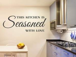 "Muursticker ""This kitchen is seasoned with love"""